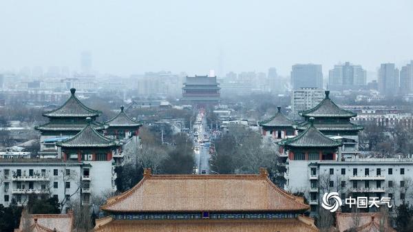 景山远眺京城雪景 故宫红墙白雪琉璃瓦美如画