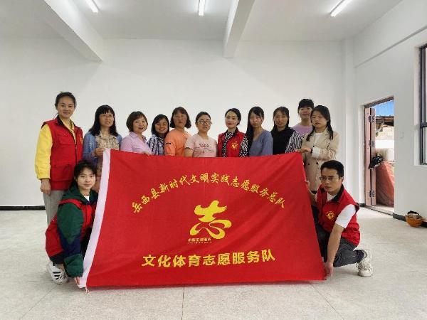 安徽省岳西县:文化志愿者开展助残活动