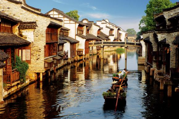 中国著名度假小镇乌镇、古北水镇联合亮相海外
