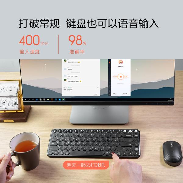 桌子上的电脑和键盘 描述已自动生成