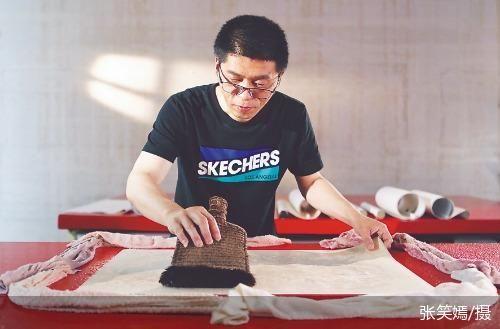 书画修复师 艺术品市场复兴的见证者